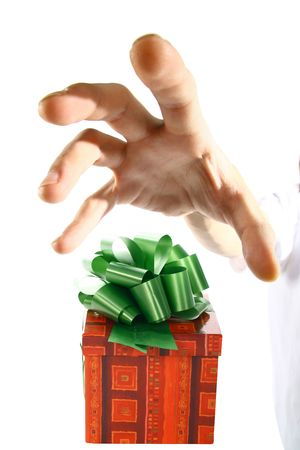 The hand tries to seize gift already soon Stock Photo - 2143656