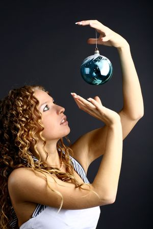 The girl with a magic New Year's sphere is very surprised holidays Stock Photo - 2143693
