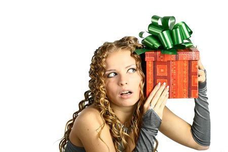 cheerfully: The girl with a gift in cheerfully box smiles new year