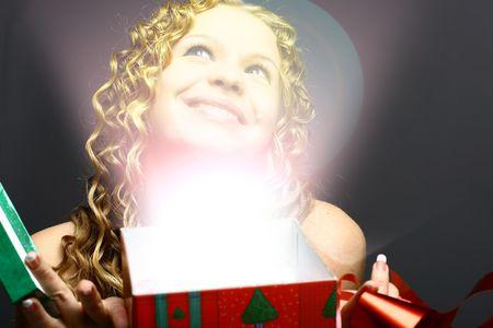 La niña en una tarjeta de navidad milagros  Foto de archivo - 2143686