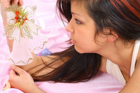 handbell: christmas girl Lays on pink handbell in hand Stock Photo