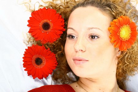 The beautiful girl lays red flowers in its hair are delightful Stock Photo - 2192973