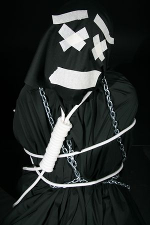 comically: black mime with black rope on himself