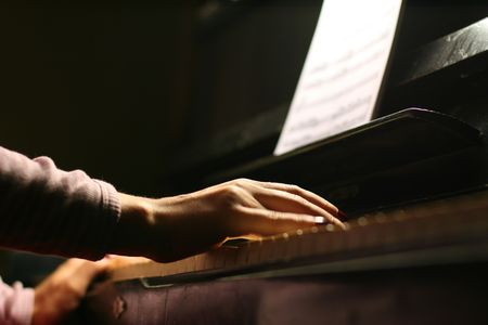female hands playing piano closeup