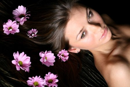 beautiful pink flowers in girl hair Stock Photo