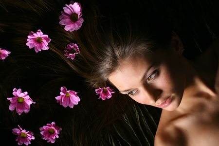 beautiful pink flowers in girl hair photo