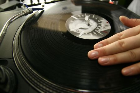 scratch battle of dj playing on his vinyls hand on Stock Photo - 2475302