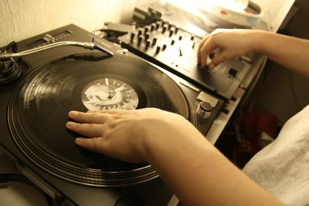scratch battle of dj playing on his vinyls hand on Stock Photo - 2486424
