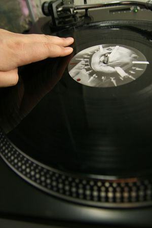 scratch battle of dj playing on his vinyls hand on Stock Photo - 2486416