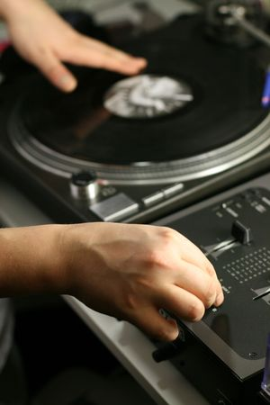 scratch battle of dj playing on his vinyls hand on Stock Photo - 2498006