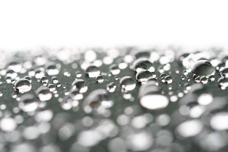 waterdrops on black light reflect on it Stock Photo