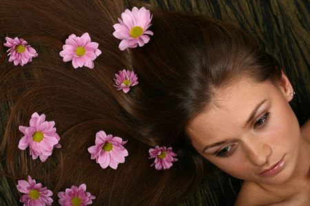 beautiful pink flowers in girl hair Stock Photo - 2521994