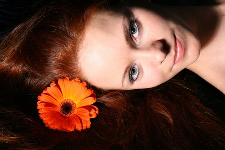 beautiful red flower in girl  hair Stock Photo - 2522000