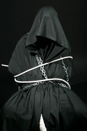 monk in black robe evil portret photo