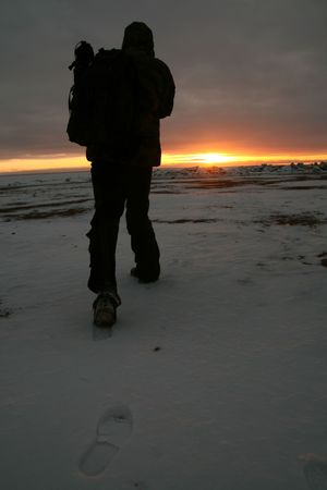 travel footprint on white snow men go to sun Stock Photo - 2613331