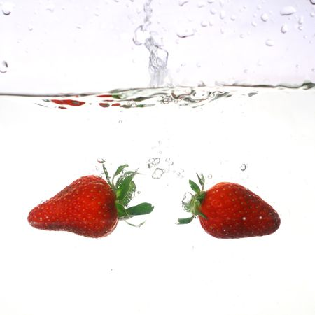 Strawberry water splash flow and bubble photo