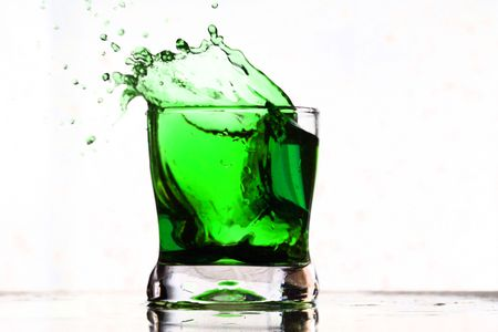 coctail drink splash isolated on white photo