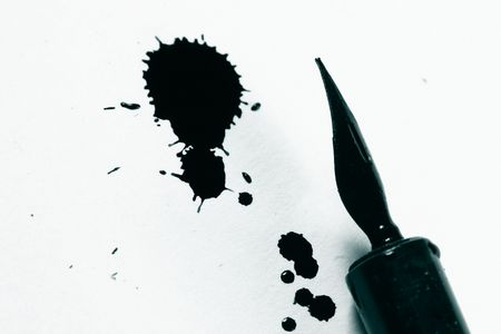 academia: ink and pen on white paper writer Stock Photo