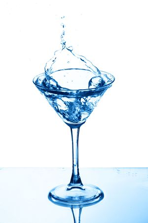martini glass splash bar background Stock Photo