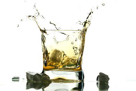 whisky splash alcohol drops isolated on white photo