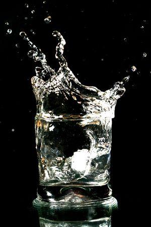 bocal: alcohol splash on black background close up Stock Photo