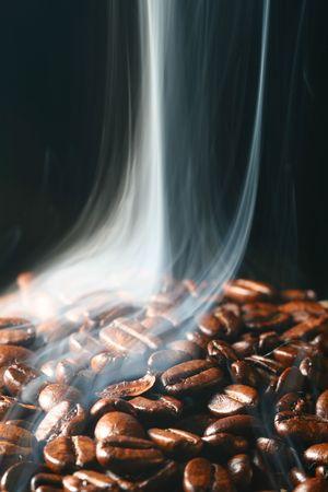 macro coffee beans in aroma smoke Stock Photo