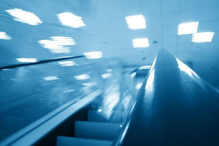 escalator transportation motion blured business background  photo