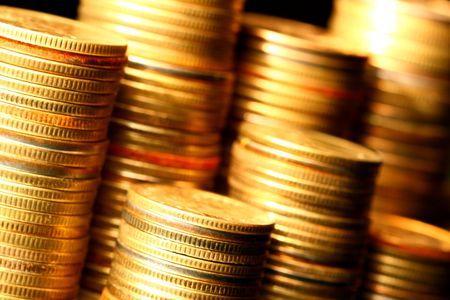 buying stock: golden coins macro close up