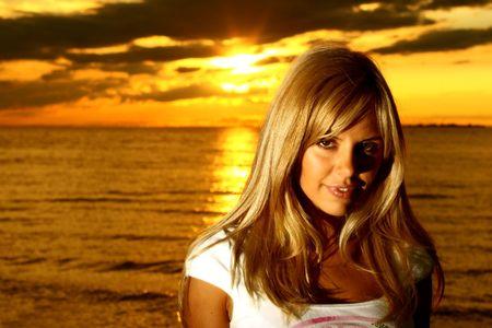 beautiful girl on golden sunset photo
