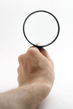 investigators: magnifier in men hand isolated