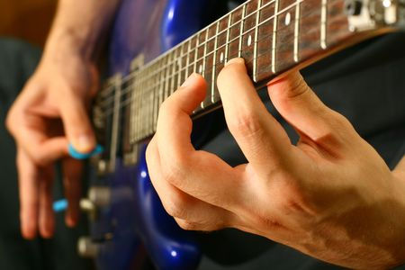 man play solo on blue guitar photo