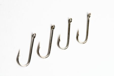fishing hooks macro close up on white