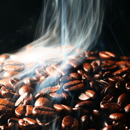 macro coffee beans in aroma smoke Stock Photo - 3464054