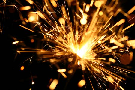 yellow sparkler holiday background on black Stock Photo - 3474311