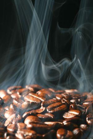 macro coffee beans in aroma smoke Stock Photo - 3474352
