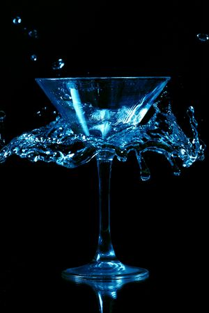 martini splash on black background close up