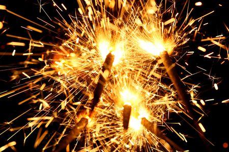 yellow sparkler holiday background on black Stock Photo - 3488019