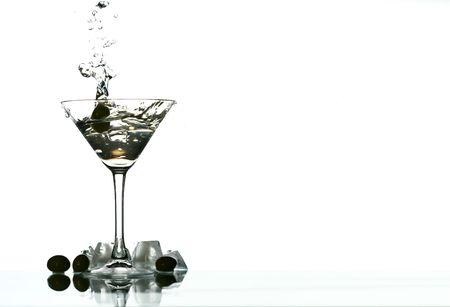 bartend: martini glass splash bar background Stock Photo