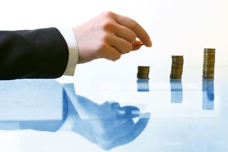 hand make coins piles on white Stock Photo - 3747855