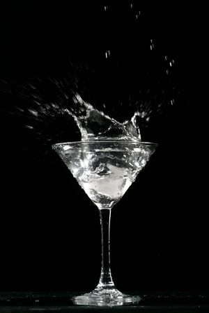 alcohol splash on black  background