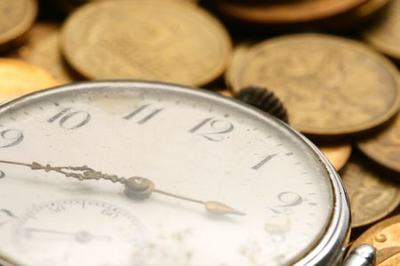 time is money coins and clock macro concet Stock Photo - 3822564
