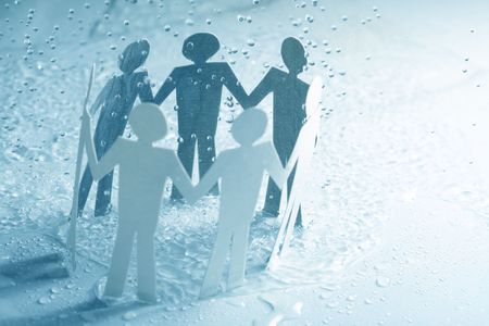 paper team linked together under rain weather concept Stock Photo - 3822647