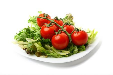 salad and cherry tomatoes isolated on white background photo