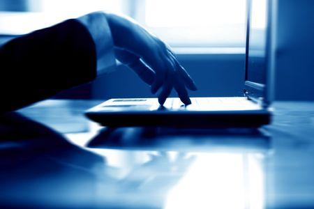 laptop work hand work background photo