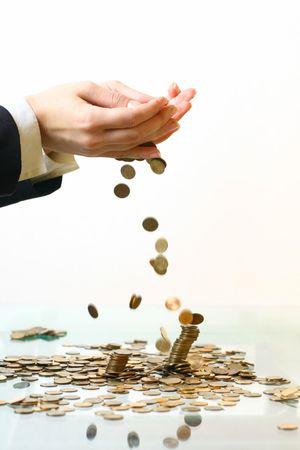 hand make coins rain on white photo