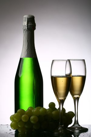 champagne grape and green bottle photo