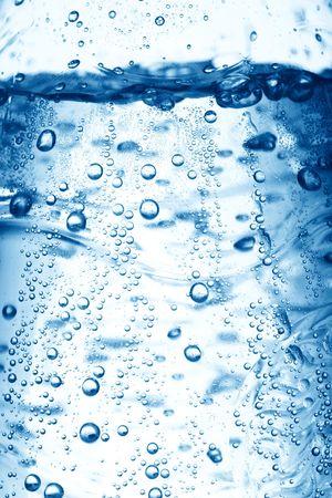 水の気泡をクローズ アップの背景
