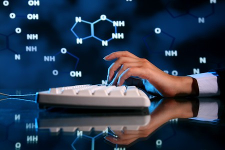 nucleic: dna information of genom typing on keyboard Stock Photo