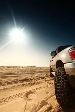 truck in desert sand and blue sky Stock Photo - 4212445