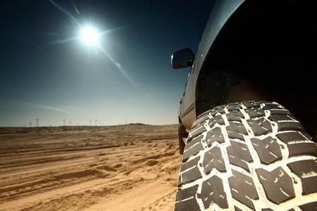 truck in desert sand and blue sky